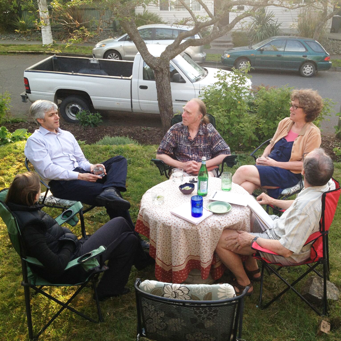Neighbours sit around a table and talk shop about resiliency.
