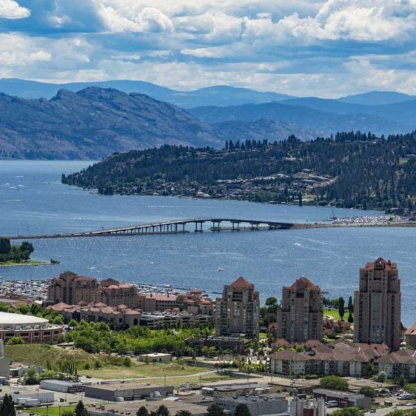 An aerial photo of downtown Kelowna, the bridge and Okanagan Lake.