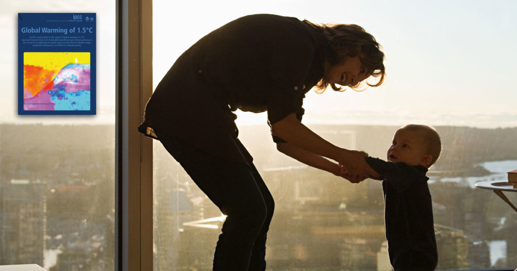 A woman holds her child's hands in the window of a Vancouver highrise, the IPCC report cover looms in the background.