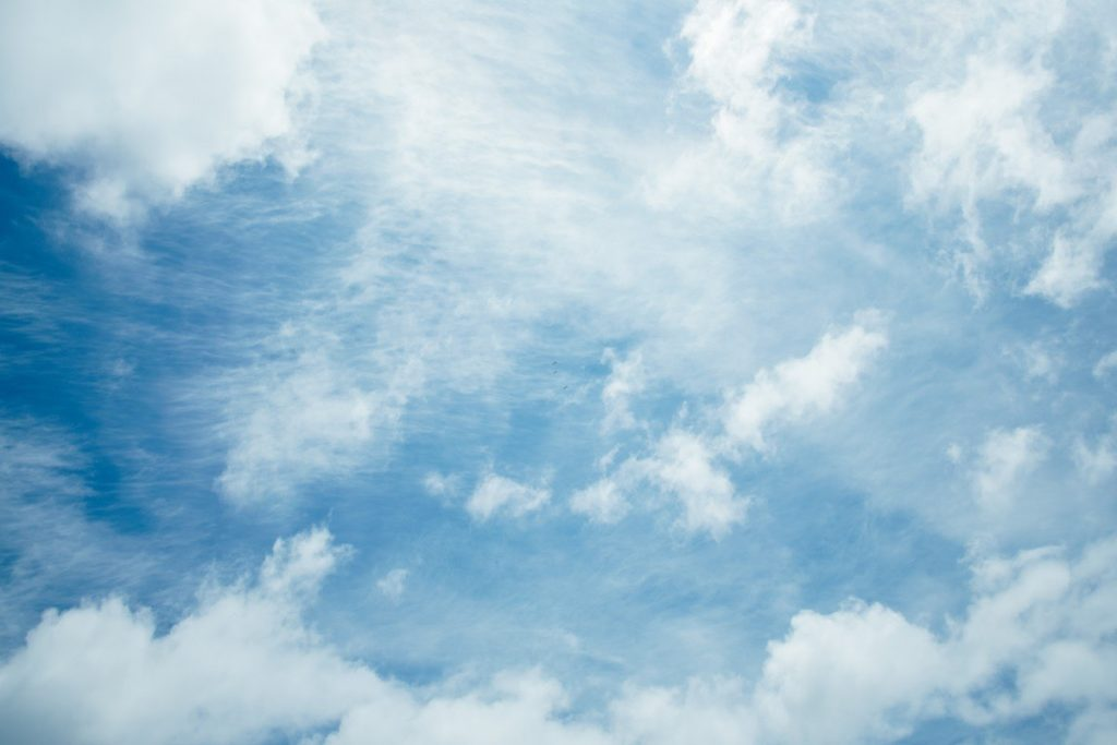 A blue sky filled with white fluffy clouds.